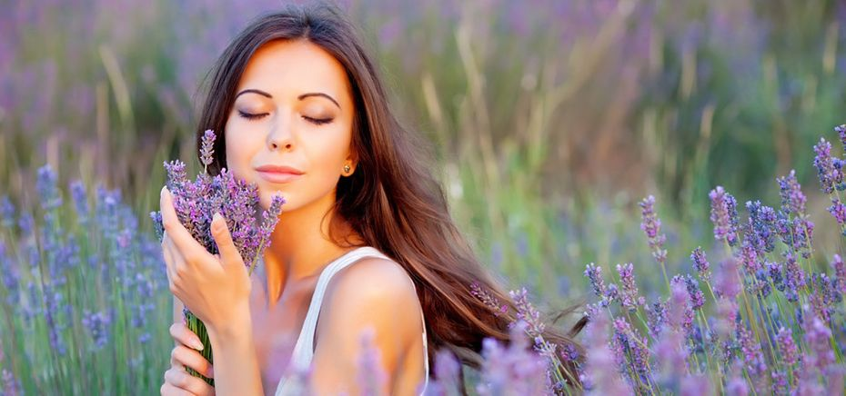relaxed woman smelling purple flowers